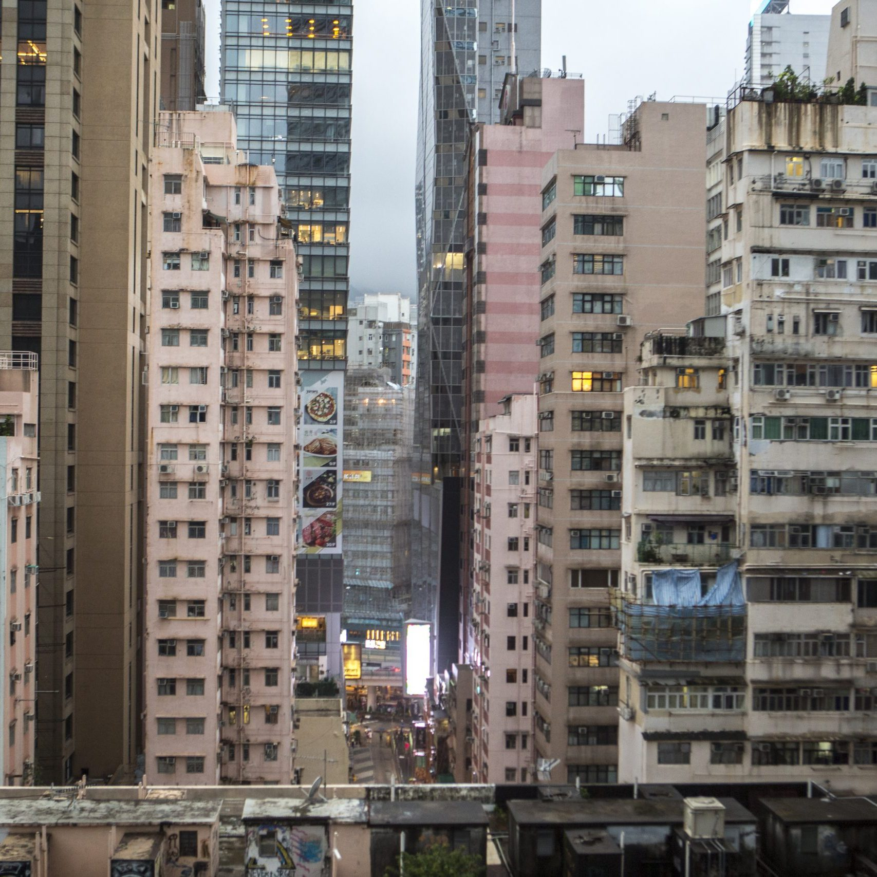 According to studies conducted by the Hong Kong Observatory, urbanization contributes about 50% of the warming in cities like Hong Kong. Concrete buildings store heat in the day and release it in the night, unbalancing the normal day and night cooling cycle. in addition, tall building block air circulation and reduce wind speed.